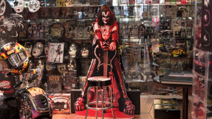 The rock band Kiss' wide reaching merchandising is on display in Gene Simmons' office in his Beverly Hills home, which he shares with his wife Shannon Tweed, as seen on HGTV Celebrities at Home. Simmons, a producer, entrepreneur and actor is the bassist and singer-songwriter of the rock band Kiss, which has sold over 100 millions albums.